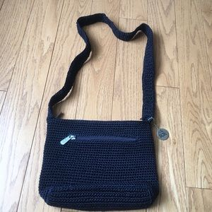 "Navy blue knit purse. Brand is ""The Sak"""